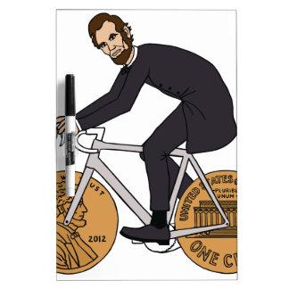 Abraham Lincoln auf einem Fahrrad mit Penny dreht Memoboard