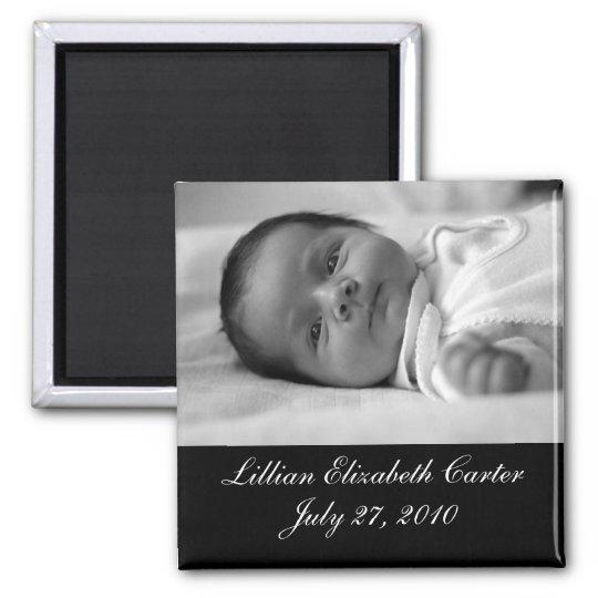 Aimant blanc noir de naissance de bébé de photo