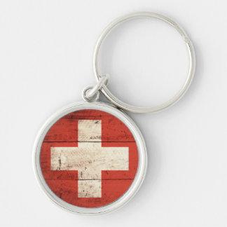 Alte hölzerne Schweizer Flagge Silberfarbener Runder Schlüsselanhänger