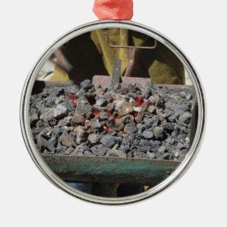 Altmodischer Schmiedeofen Rundes Silberfarbenes Ornament