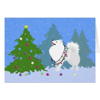 Amerikanischer Eskimohund, der Weihnachtsbaum Grußkarte