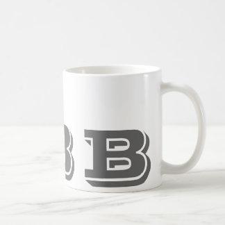 Anfangsb graue moderne Kaffee-Tasse des Monogramm- Tasse