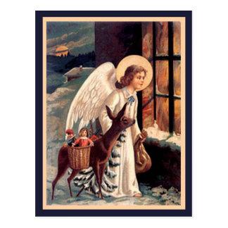 Ange de Noël avec la carte postale de cru de cerfs