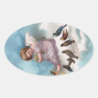 Ange et oiseaux sur le cru Pâques de nuage Sticker Ovale