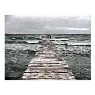 Anlegestelle an der stürmischen Küste Postkarte