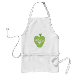 Apple et tablier verts de professeur de coeur