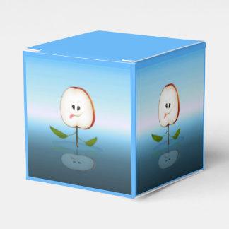 Apple stellen gegenüber geschenkschachtel