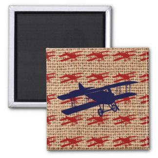 Avion vintage de propulseur de biplan sur la copie magnets