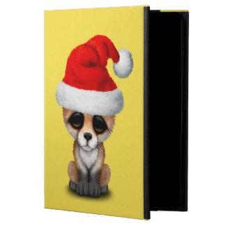 BabyFox, der eine Weihnachtsmannmütze trägt