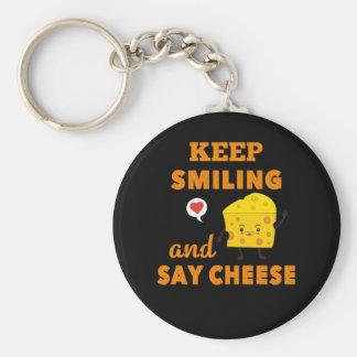 Behalten Sie das Lächeln und sagen Sie Schlüsselanhänger