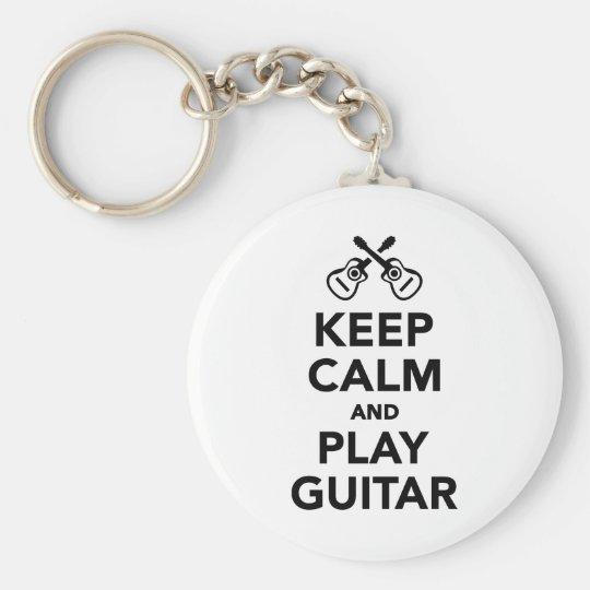Behalten Sie Ruhe und Spielgitarre Schlüsselanhänger
