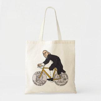 Ben Franklin auf einem Fahrrad mit Dollar-Rädern Tragetasche