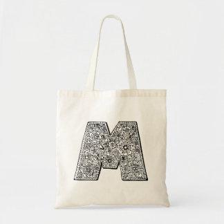 Bibliothekstasche der Farbe des Buchstaben M sich Tragetasche