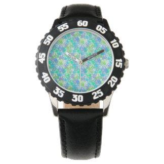 Blaue und grüne Edelsteine. Uhr