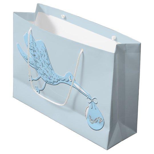 Blauer Storch, der Jungen liefert Große Geschenktüte