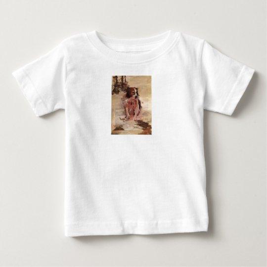 Border-Collie im Schnee auf dem T-Shirt des Kindes