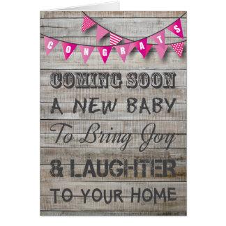 Carte Bébé rose d'étamine de félicitations rustiques de