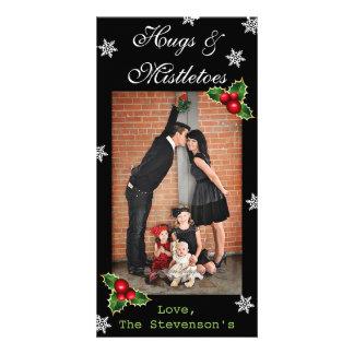 Carte Noël de verticale d'étreintes et de guis