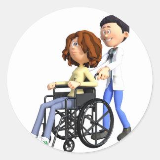Cartoon-Doktor Wheeling Patient In Wheelchair Runder Aufkleber