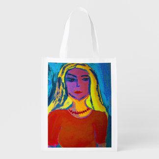 Cendre d'achat réutilisable jeune femme blonde sacs d'épicerie