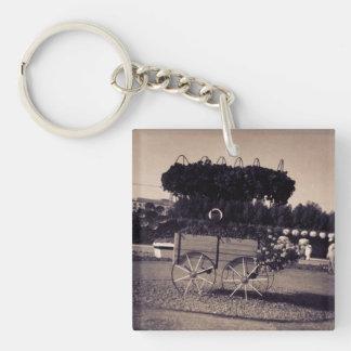 Chariot vintage de fleur porte-clé carré en acrylique double face