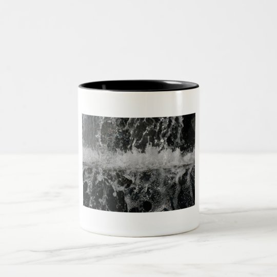 Coffe Tasse mit einem Spritzen