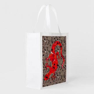 Collage rouge de lézard sac d'épicerie