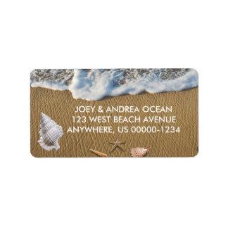 Coquillages sur la plage étiquette d'adresse