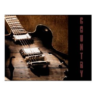 Countrymusik-Gitarre auf ledernem Hintergrund Postkarten