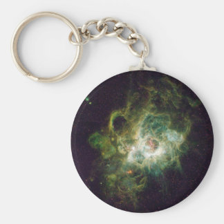 Crèche des étoiles dans une galaxie en spirale porte-clé rond