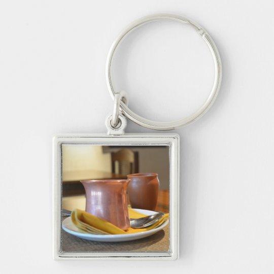 Das Bronzeglas Schlüsselanhänger