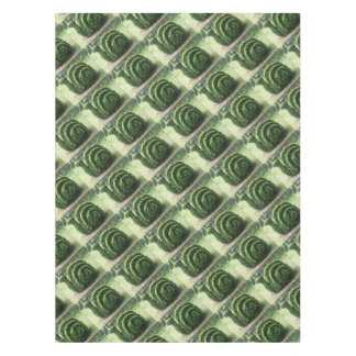 Dekorativer Topiarygrün-Gartenschneckebusch Tischdecke