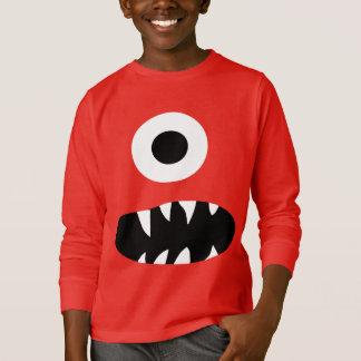 Der lustiger scherzt mit Augen Monster-Gesicht des T-Shirt