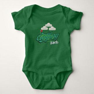 Der niedliche kleine Caddie-grünes Golf spielendes Baby Strampler