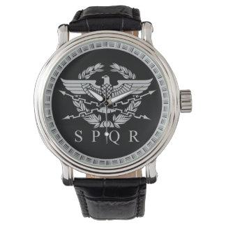 Die römisches Reich-Emblem-Uhr Uhr