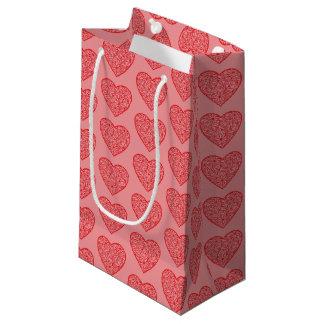 Die roten Herzen des Valentinsgrußes Kleine Geschenktüte