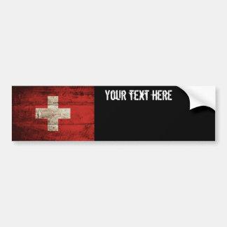 Die Schweiz-Flagge auf altem hölzernem Korn Autoaufkleber