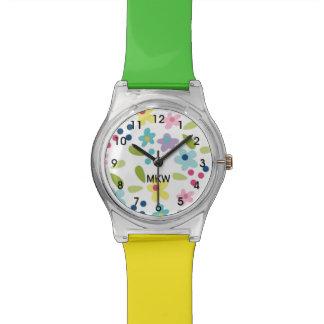 Die Uhr des bunten Funky Blumen-Mädchens
