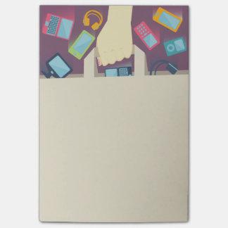 Digital-Geräte, die in eine PapierEinkaufstasche Post-it Klebezettel