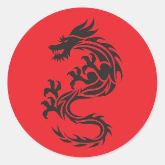 Dragon du feu autocollant rond