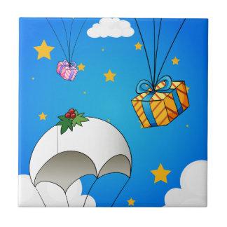 Drei Fallschirme mit Geschenken Fliese