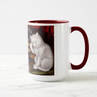 Drei weiße Katzen nach dem Fest und Tasse