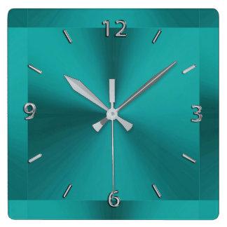 Dunkle aquamarine grüne metallische Uhr