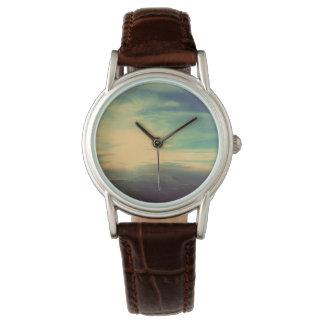 Durchbruch-glänzende Wolken-Uhr Uhr