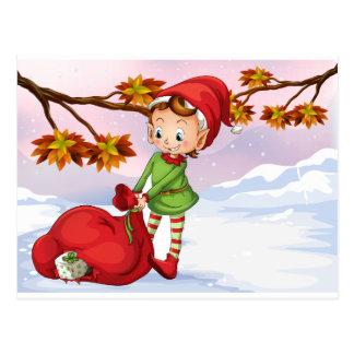 Ein Elf, der eine Tasche der Geschenke hält Postkarte