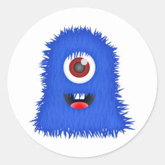 Ein mit Augen blaues Monster Runder Aufkleber