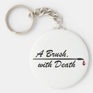 Eine Bürste, mit Todeslogoschlüsselring Schlüsselanhänger