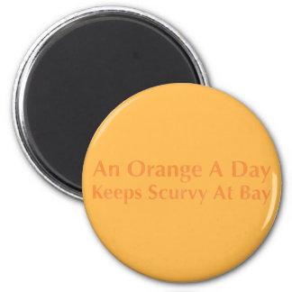 Eine Orange ein Tag behält Skorbut an der Bucht Runder Magnet 5,1 Cm