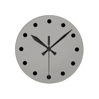 Einfache graue Uhr mit schwarzen
