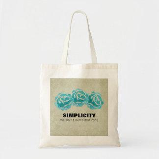 Einfachheits-Typografie-Zitat mit aquamarinen Tragetasche